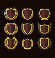 golden shields laurel wreaths badges collection vector image vector image