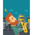 Saxophonist playing in the streets at night vector image