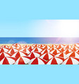 many red and white sun umbrellas on a beach vector image