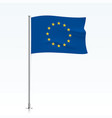 european union flag waving on a metallic pole vector image vector image