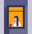 brunette woman sitting and looking out window vector image