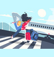girl carrying baggage on trolleys for flight vector image