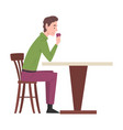 young man sitting at table in cafe guy drinking vector image