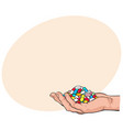 side view hand holding pile handful of pills vector image vector image