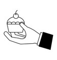 hand holding cupcake vector image vector image