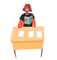 pupil reading book sitting at desk in school vector image vector image