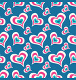 colored hearts on a blue background seamless vector image