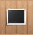 photo frame placed on a wooden background vector image