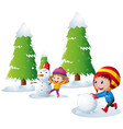 two kids playing snowman in the snow field vector image vector image