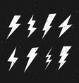 black and white grunge retro lightning bolt set vector image