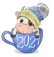 cartoon bull is sitting in a cup coffee vector image vector image