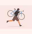 Male carrying broken bike to repair service