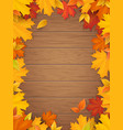 autumn leaves on wooden background vector image vector image