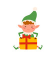 cute christmas elf sitting with decorated present vector image vector image