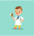 smiling little kid in doctor s uniform and vector image vector image