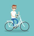 young nerd riding a bike and waving his hand vector image