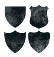 vintage distressed grunge badges or shield vector image