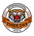 international tiger day emblem with angry tiger vector image vector image