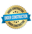 under construction 3d gold badge with blue ribbon vector image vector image