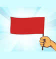 man holding in his hand a red flag vector image vector image