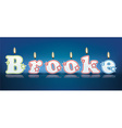 BROOKE written with burning candles vector image vector image