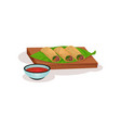 spring rolls with meat and vegetables on wooden vector image vector image
