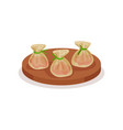 appetizing shrimp dumplings of round wooden plate vector image