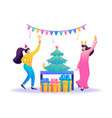 young girls have fun near christmas tree flat vector image