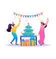 Young girls have fun near christmas tree flat