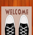 Feet teen in sneakers close up on a doorway rug vector image vector image