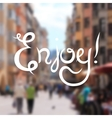 Enjoy hand lettering design inscription on blur vector image