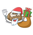 santa with gift bundt cake mascot cartoon vector image vector image