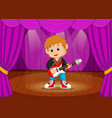 young boy playing electric guitar on stage vector image