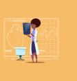 Female african american doctor examining xray
