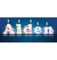 AIDEN written with burning candles
