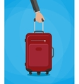 red travel bag with hand vector image vector image