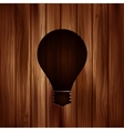 Light bulb icon Wooden texture vector image