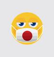 emoji medical mask shaped like an japan flag vector image vector image
