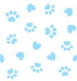 seamless background with paw prints and hearts vector image vector image