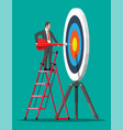 businessman on stepladder aim arrow to target vector image