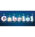 GABRIEL written with burning candles vector image