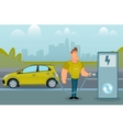 Man charging his electric car at the station vector image vector image