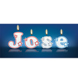 JOSE written with burning candles vector image vector image
