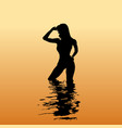 silhouette of a woman in the sea at sunset vector image vector image