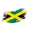 jamaican flag grunge brush background vector image vector image