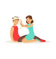 woman bandaging the head of the injured man first vector image