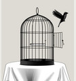 bird cage and a black bird flying away vector image