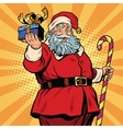 Santa Claus with a gift Christmas and new year vector image vector image