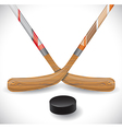 Hockey sticks and hockey puck vector image