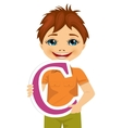 little boy holding the c letter vector image vector image